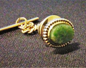 MTie Tack Gold Color and Green Stone in Middle..Pre Owned