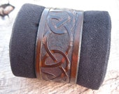 Mens Leather Cuff Bracelet with Hand Tooled Celtic Locked Tight Knot Line design custom made to order. Free shipping.