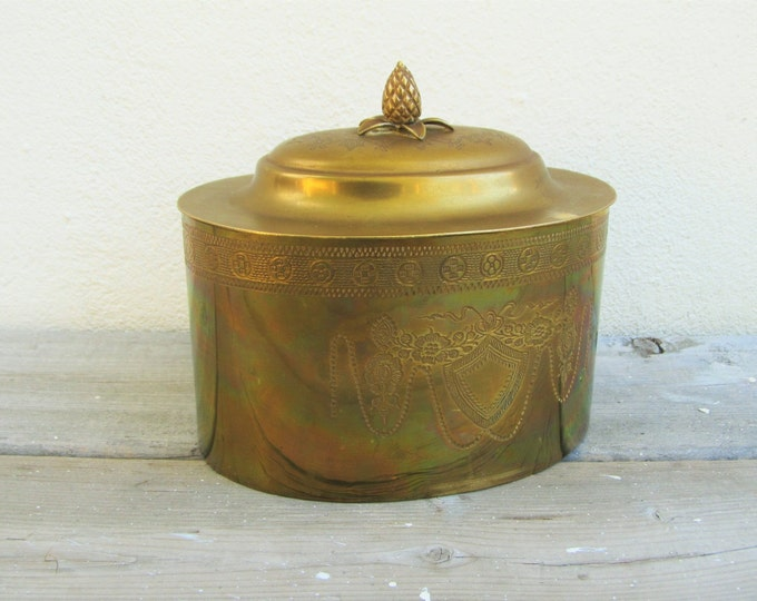 Decorative Brass box, vintage oval brass storage box, engraved with shield, flowers and garlands, with acorn handle on the lid, cookie jar