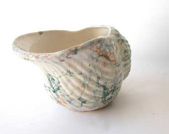 pretty marbled china jug or moustache cup