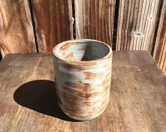 Shino Glazed Cylinder, the price on this on is to establish a free art school in Santa Monica
