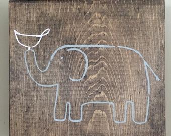 Grey elephant with pink bird