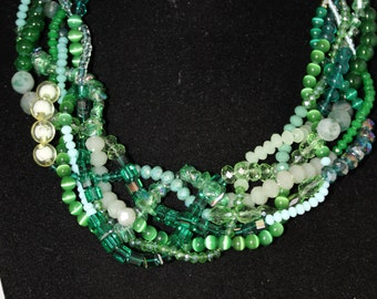 Necklace neckline with pearls, beads, crystals and semiprecious stones entwined green color