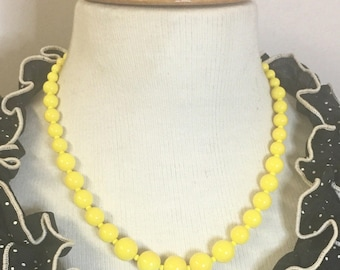 Darling - Retro inspired graduated glass bead necklace in buttercup yellow by Seditious Jewelry