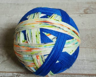 Hand Dyed Self Striping and Speckled Sock Yarn ~  Here There Be Dragons ~ blue stripes, neon green, neon orange, black and blue speckles