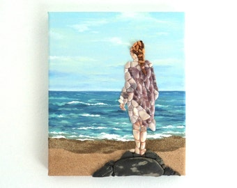 Girl on Rock Looking out to Sea in Seashell Mosaic on Sand