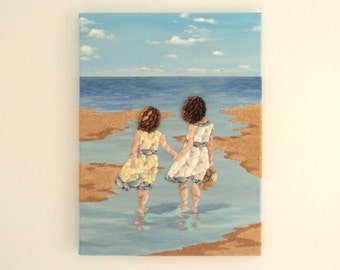 Young Girls Paddling on the Beach in Seashell Mosaic & Sand