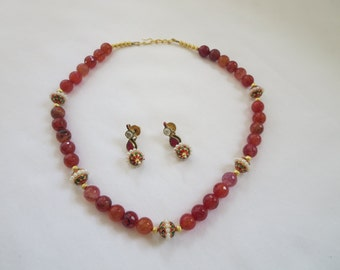 Beautiful custom designed necklace set made from rust color beads along with meenakari and pearls manka in between.
