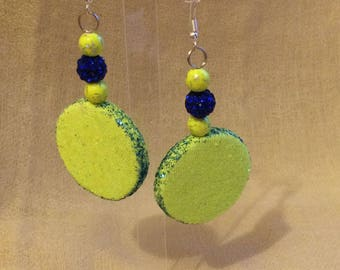 Neon yellow earrings and blue contrast