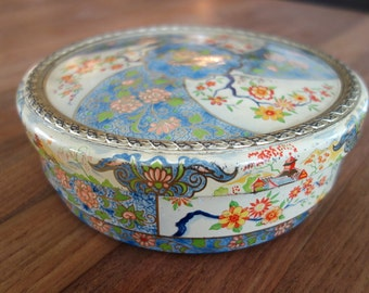 Beautiful vintage round cake or cookie tin with Japanese style flower decoration