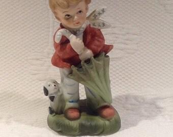 "Figurine ""Hummel style"" porcelain - boy to the umbrella / / made in Korea"