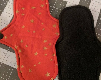 TWO cloth pads. Red with gold stars, cotton topped fleece backed mama cloth, RUMPs