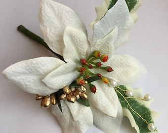 Single Christmas Buttonhole with White Poinsettia, Gold Berries, Holly and Pearl Stems