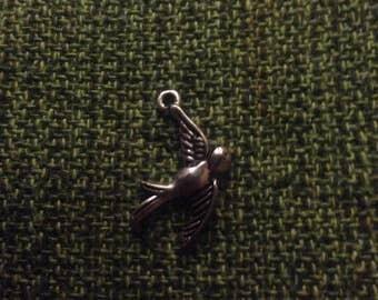 Sterling bird charm