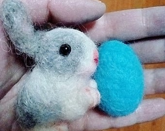 "Needle Felted Bunny Rabbit with blue easter egg.  2"" long x 2"" high"