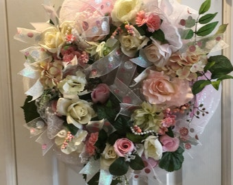 Spring wreath with roses, ribbons, pearls, lace