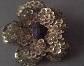 Gold sequin flower brooch