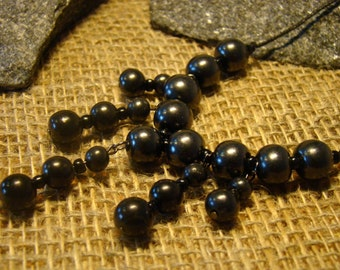 Shungite necklace of beads of Karelia.