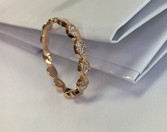 14k Rose gold band with white diamonds