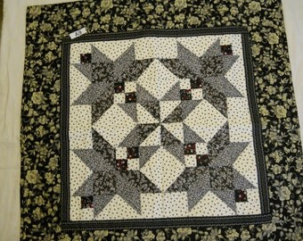 A9 black star with a hint of red quilted table topper