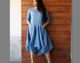 Blue linen dress with embroidered pockets