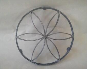Cast iron trivet / table mat