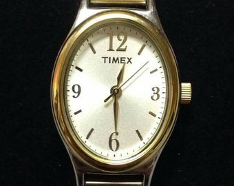 Ladies Timex oval two tone dress watch