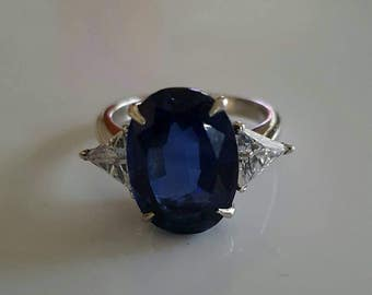 Blue oval side trillion cut sterling silver ring