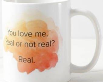 You love me. Real or not real, The Hunger Games mug, gift mug, mothers day, friends mug, sisters mug, coffee cup