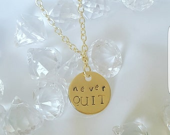 Necklace with never QUIT pendant
