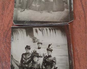 Wish You Were Here:  Lot of 2 Antique Tintype Photographs of Groups Posing Before a Studio Set of Niagara Falls