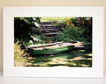 Mounted Photograph of a Green Boat on a Garden Pond