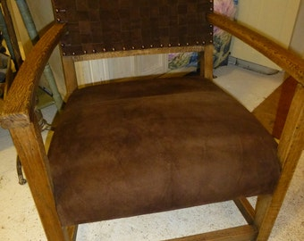 Oak chair with brown suede seat and woven back