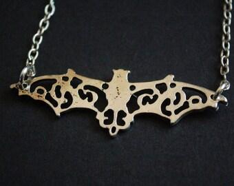 Silver tone filigree batman necklace