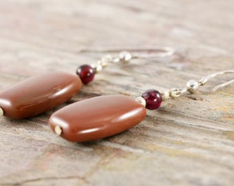 Caramel agate sterling silver dangle earrings with red garnet accent