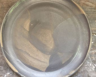 Large dish in sandstone