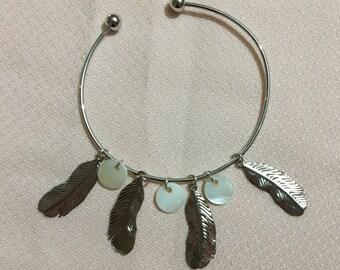 Hanging metal bracelet