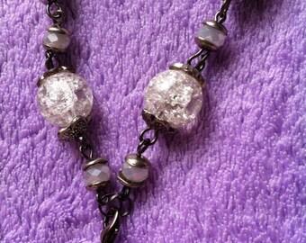 Plait with bead pendant