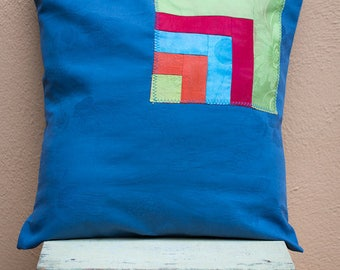 Upcycling pillow blue with colorful patterned application