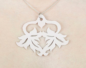 Leaf cutout pink leather pendant necklace