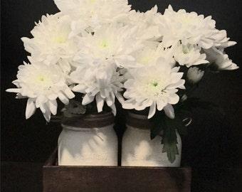 Rustic mason jars in wood flower box