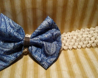 Blue fabric paisley bow on band.