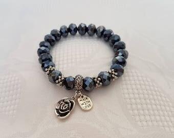 Dark grey stretch glass bead bracelet with silver-tone charms