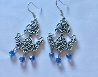 Silver Pale Blue Chandelier Dangly Earrings with Swarovski Crystals On Sterling Silver Ear wires.