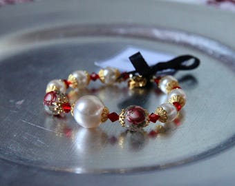 White pearl bracelet with painted rose beads and Swarovski crystals