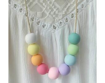 Rainbow Polymer Fimo Clay Bead Necklace on tan cord
