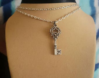 Black ribbon with 2 silver chain layers with key pendant