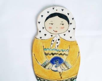 Wall pottery nesting lady mustard sweather