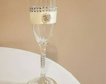 Wedding champagne flutte with satin ribbon, brooch and rhinestones