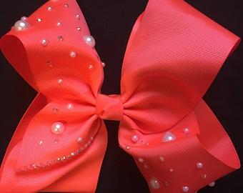 neon orange bow with pearls and rhinestones